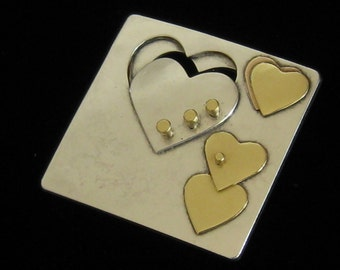 Modernist Hearts Brooch in Mixed Metals.  4 Layers Primarily Silver with Brass and a Touch of Copper Design Elements.  1.5 Inches Square.