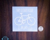 My other ride is brakeless - Cut vinyl decal in white