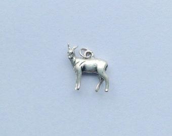Small vintage antelope charm