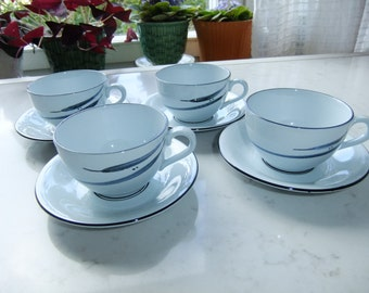 Vintage Swedish set of four rare coffee/tea cups and saucer - Orion Rörstrand - Eva Bengtsson decor