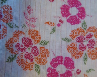 "Pink, orange and white floral knit fabric remnants, one 33"" by 64"" and the second is 22"" by 12"""