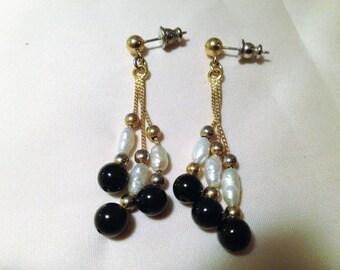 Onyx and pearl dangle earrings.