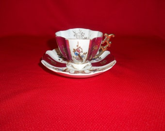 One (1), Porcelain, Footed Demitasse Cup & Saucer, from Saji China, of Occupied Japan.