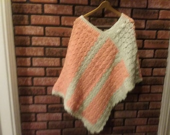 Peach and winter white.ladies or teenagers, crocheted poncho, One Size Fits most.