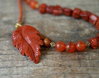 Carved jasper leaf necklace Carnelian and sponge coral necklace Nature inspired jewelry Dark orange rust beads on braided leather necklace