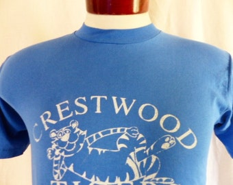 cute kawaii vintage 80's Crestwood School Tigers blue graphic t-shirt white varsity mascot print curve logo unisex hanes made in usa  medium