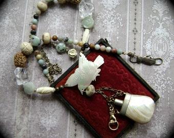 Soaring Scents, assemblage necklace, vintage perfume bottle, carved mop bird, ceramic rose, carved stone, bronze hand clasp, AnvilArtifacts