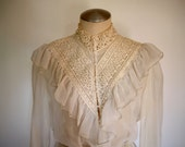 70s ivory light ruffle long sleeve gunne sax blouse with high lace collar, peplum & tie