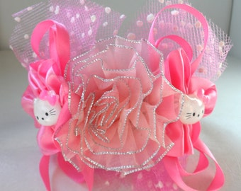 Couture collar. Central pink net flower with silver edging, side cerise faux satin ruffles, HK motif,bows and polka dot net. OOAK
