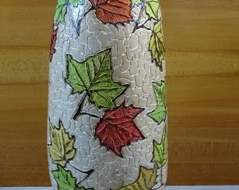 Unique handmade gourd lamp with colourful autumn leaves pattern.
