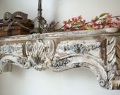 Large ornate wooden shelf wall hanging French farmhouse style shelving rose garland embellished painted wood home decor anita spero design