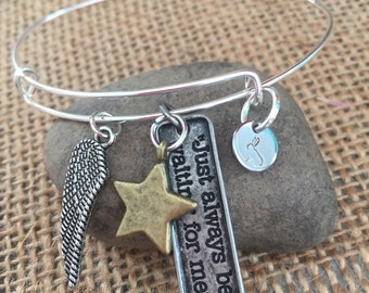 Sterling silver bangle charm bracelet.  Peter pan