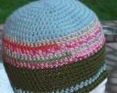 Blue green top with pink and dark green crochet beanie hat