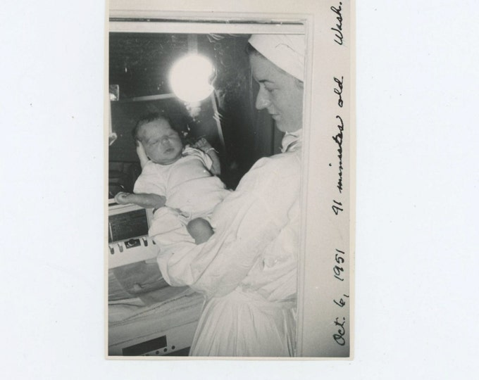 Photographer, Camera and Flash Reflection in Nursery Window, Nurse Holds 41 Minute-Old Baby,  1951 Vintage Snapshot Photo [65457]