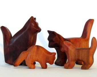 Cat family carved from plum wood