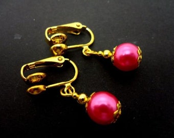 A pair of pretty pink  glass pearl  bead  dangly clip on earrings.
