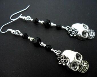 A pair of tibetan silver skull flower black bead long dangly earrings.