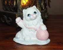 Vintage Porcelain Blue Eyed Fluffy White Kitty Cat with Pink Yarn Ball Taper Candle Holder Statue Figurine