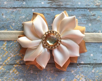 Ivory and gold bow.