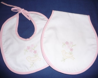 Hand embroidered bib and burp cloth set.