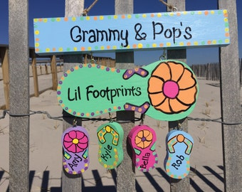 Personalized grandparent beach flip flop sign with hanging grandchildren