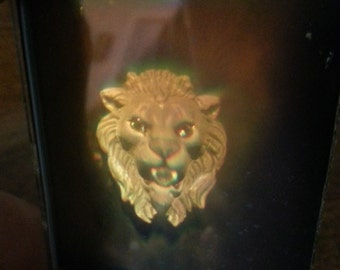 Vintage 1980s 3D glass hologram of a lion with diamonds for eyes