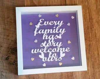 Every family has a story welcome to ours floating papercut framed