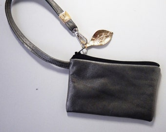 Leather wristlet or coin purse in rich platium color leather.  Perfect  to hold a gift card.