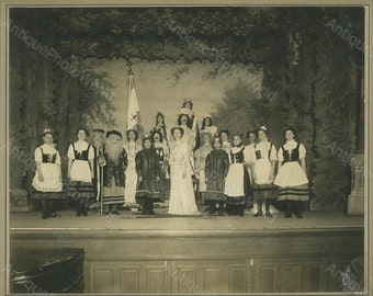 Theater play actors in costumes on stage antique photo