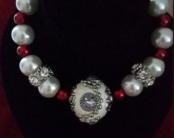 red, white , and silver shiny bracelet