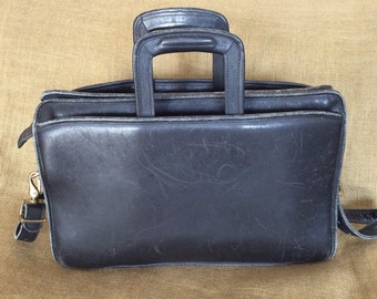 Vintage JACK GEORGES black leather briefcase with shoulder strap retractable handles