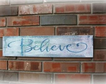 blue BELIEVE sign