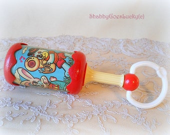 Old baby rainmaker tube shaker music sensory auditory melodious sound instrument or baby rattle made of plastics by Long Key