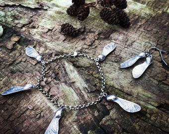 Sterling silver charm bracelet with sycamore seeds