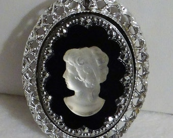Fancy Cameo Scrollwork with Onyx back and Translucent Womens Siloette in Lucite