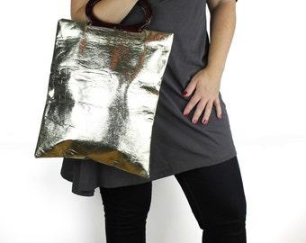 Shiny Gold Vintage Vinyl Expandable Handbag with Plastic Tortoise Shell Handle