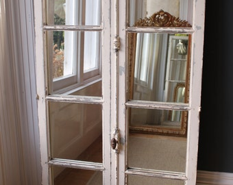 A Pair of antique French window mirrors