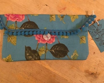 Make-up bag made from my Colourful Camelia fabric, fringed with pompoms.