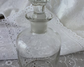 Decanter, glass with cut glass stopper, antique