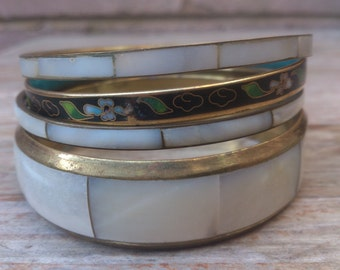 lot of four brass,enamel and mother of pearl bangles
