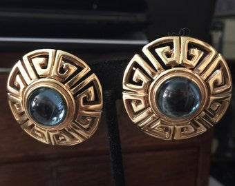 A pair of 1980s P and M,Paris earlobes,earrings,clip on fashion in gold tone metal and blue cabochon stones