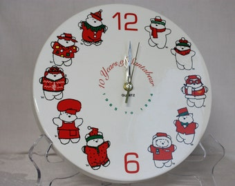 1994 Santabear ceramic clock, 10 years of Santabear, 1 double AA quartz movement, 10 inches wide