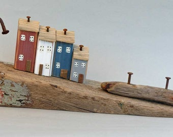 Sloping Driftwood with 4 little houses and rusty nails #393