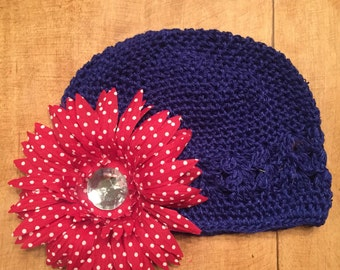 Navy blue beenie w red and white polka dot flower