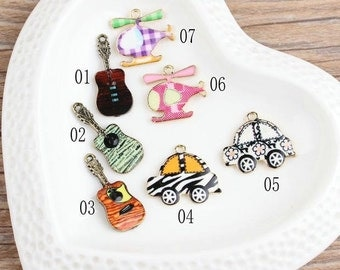 10 pcs of antique gold multicolour car guitar and helicopter charm pendants