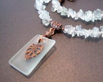 Pale Green Necklace with glass pendant and copper tropical leaf charm; 19 inch necklace