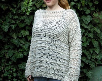 Knitted women's light beige sweater. Loose knit sweater. Oatmeal sweater.