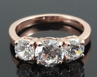 Three Stone Round Cut Trilogy Cubic Zirconia Engagement Ring in 18K Rose Gold