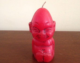 vintage red asian buddha candle