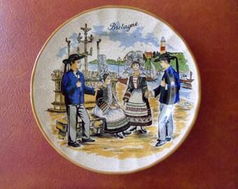 Decorative porcelain plate Vintage French Bretagne souvenir porcelain plate showing men and women in traditional Breton costumes